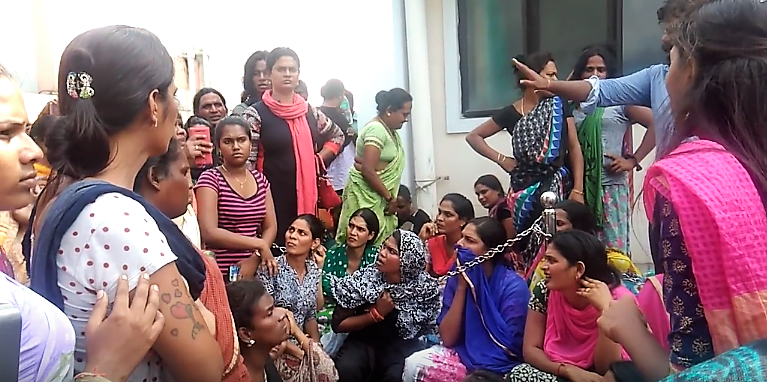 Protestors gather outside Kilpauk Medical Hospital. Credit: You Tube/Sathish Inayav