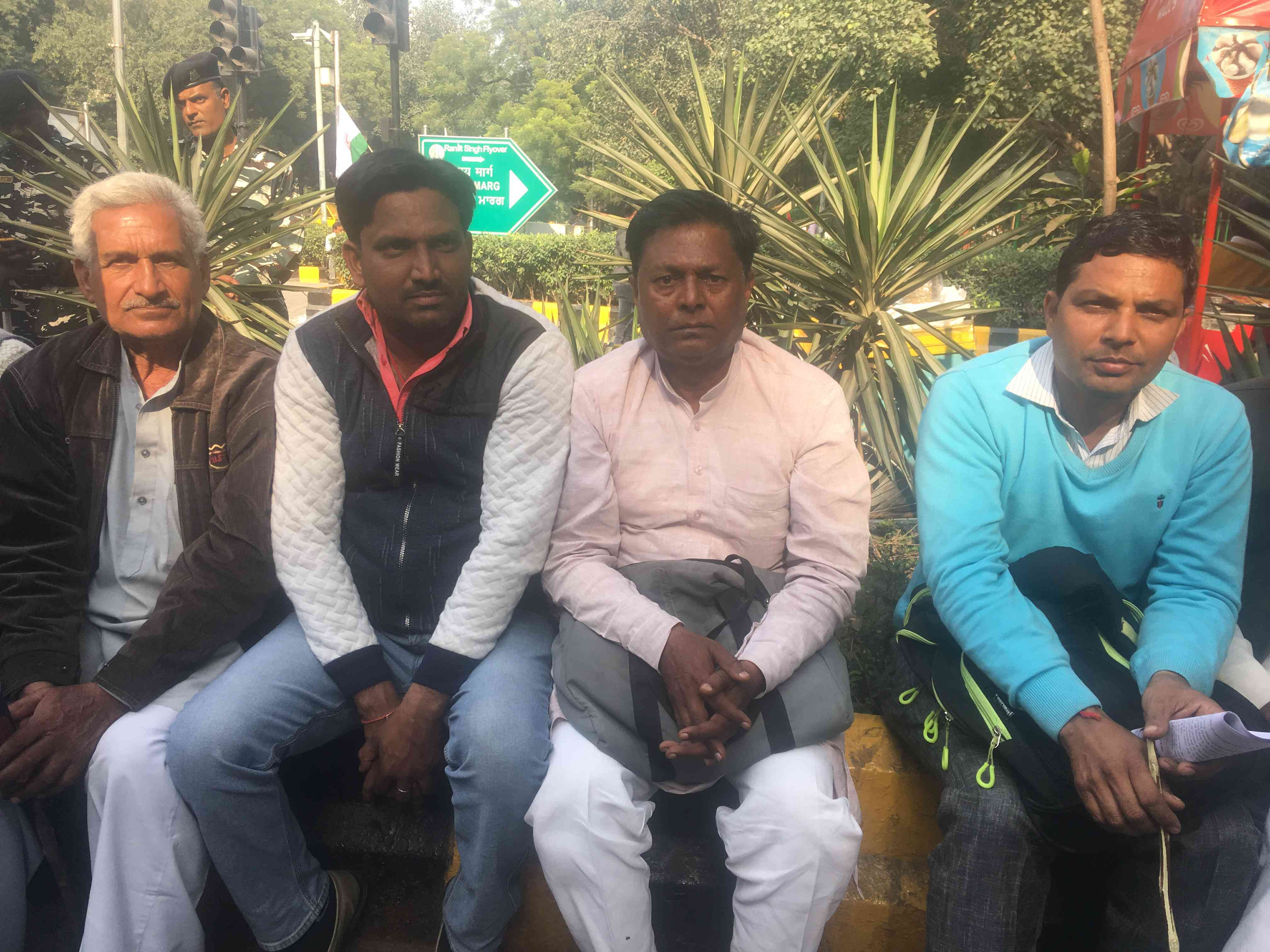 Vijendar Kumar (second from right) and other farmers from Haridwar say they have not received payments from the government for their sugarcane for two years now.