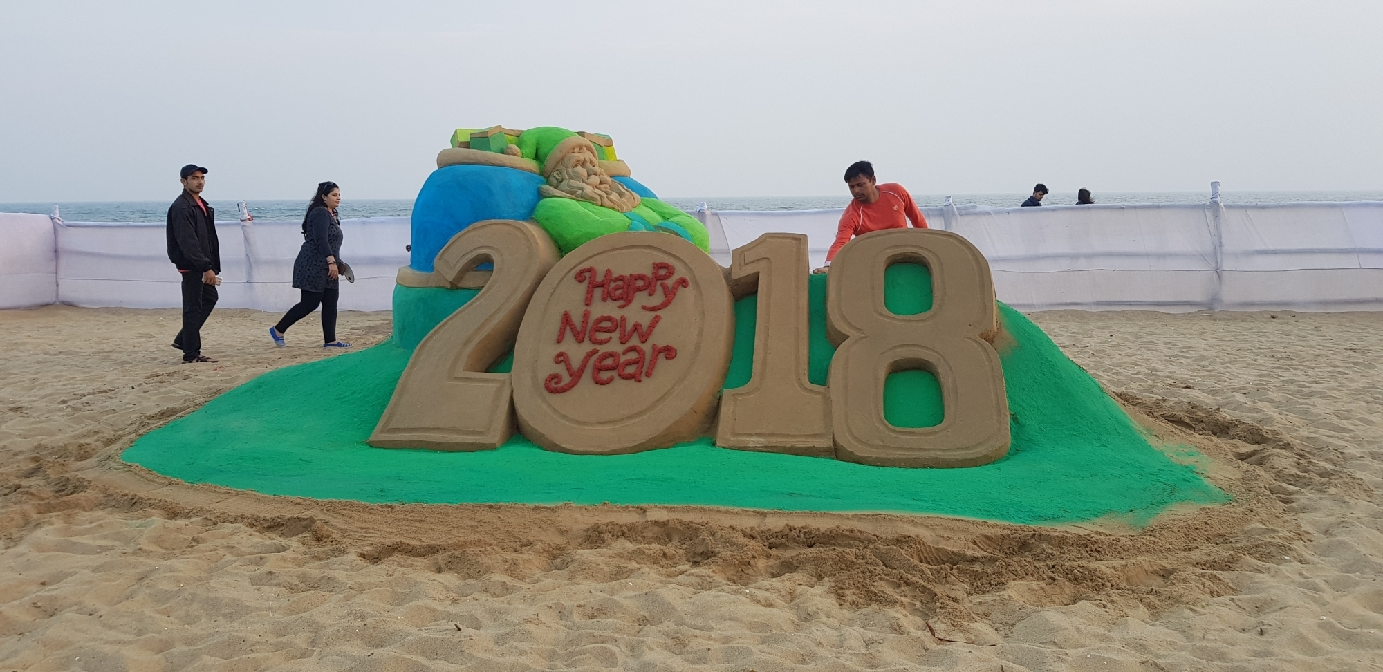 Sand Artist Manas Sahoo bids adieu to 2017 and welcomes 2018 with his sand sculpture on the New Year's Eve at Puri Beach in Odisha. (Image Credit: IANS)