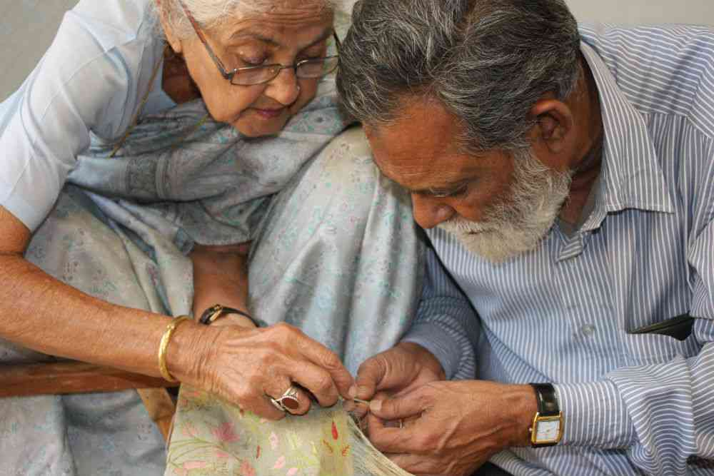 Suraiya Hasan Bose and Syed Omar, the master weaver, work on a complicated jaala.
