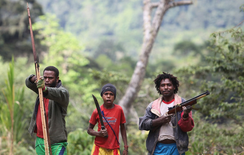 Armed Papuans in West Papua, which along with Papua province forms the Indonesian half of New Guinea Island. Photo credit: Rhett Butler/Mongabay
