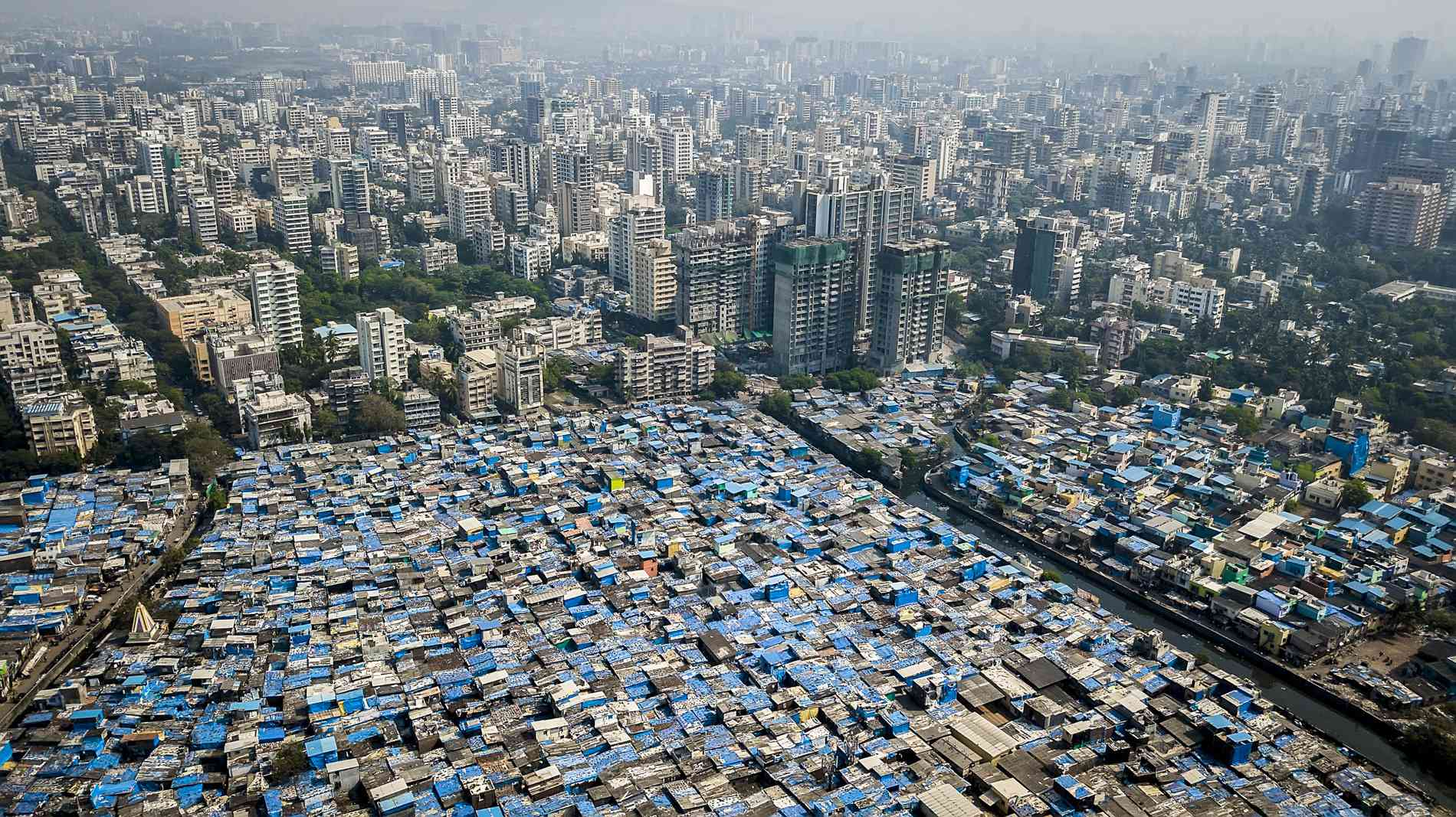 Luxury townships, modest buildings and slums share space in an immensely crowded city. Affordable housing remains a distant dream in Mumbai.