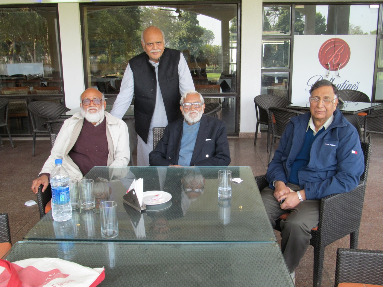 From left, CM Naim, historian Saleem Kidwai (standing), Ram Advani and book collector Aslam Mahmud. Photo: Unknown waiter at Lucknow golf course, February 2015, via CM Naim.