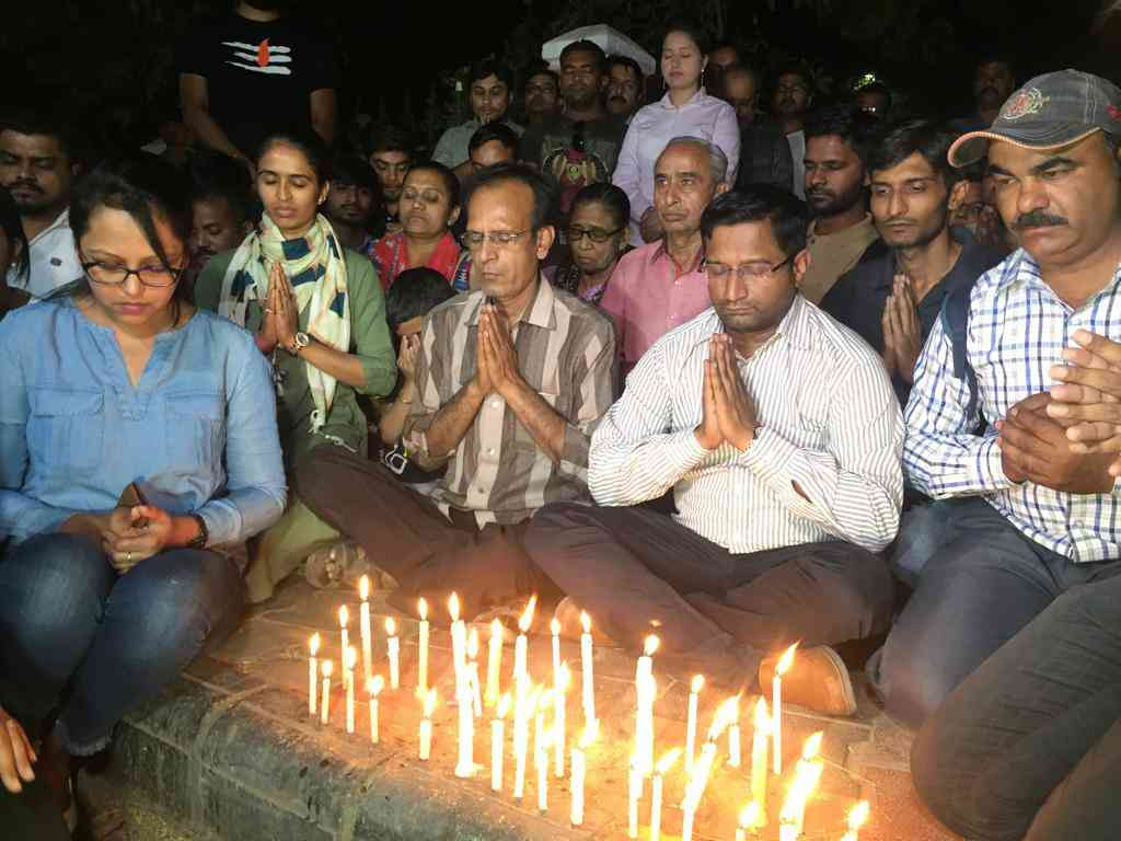 Journalists at a candlelight vigil for Chirag Patel on March 19. (Photo courtesy: Sagar Patel).