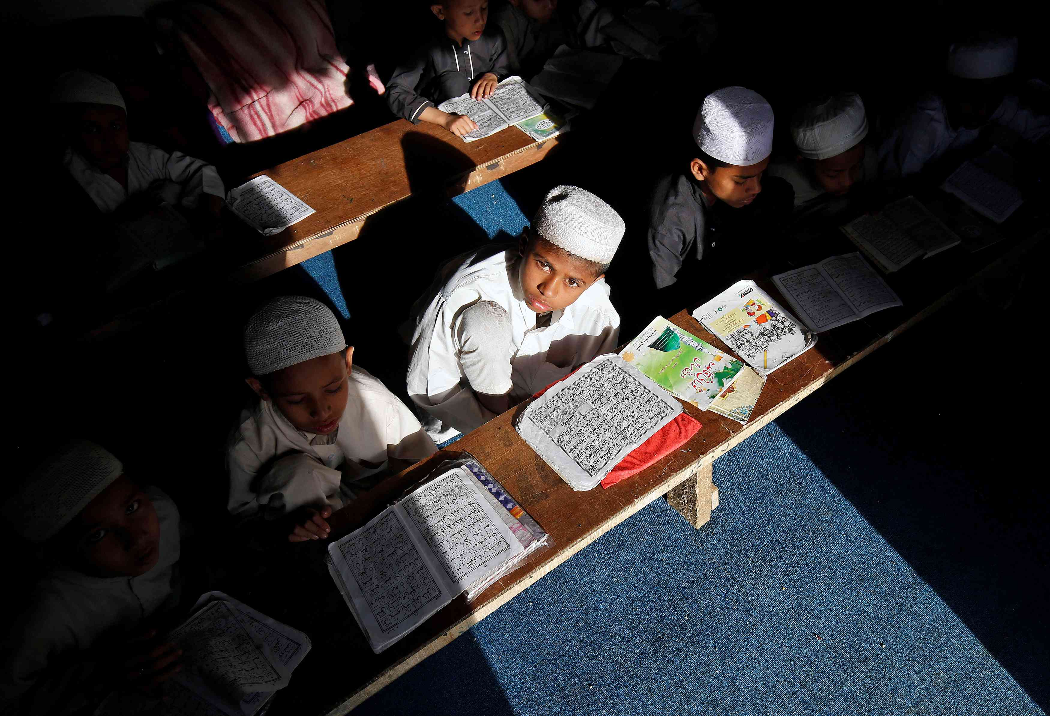 Rohingya children study at a madrasa in a refugee camp on the outskirts of Jammu. Photo credit: Reuters