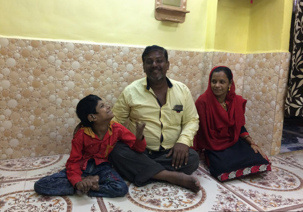 Javed Shaikh with his parents Samsunisa and Abdul Rahman in their new home. Javed's family had to move to Mumbra in Thane district after their slum in Sewri was demolished. Javed no longer goes to school. (Photo credit: Swagata Yadavar/Indiaspend.com)