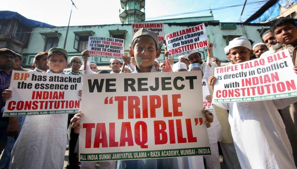Boys pose with placards protesting the triple talaq Bill in Mumbai. (Credit: PTI)