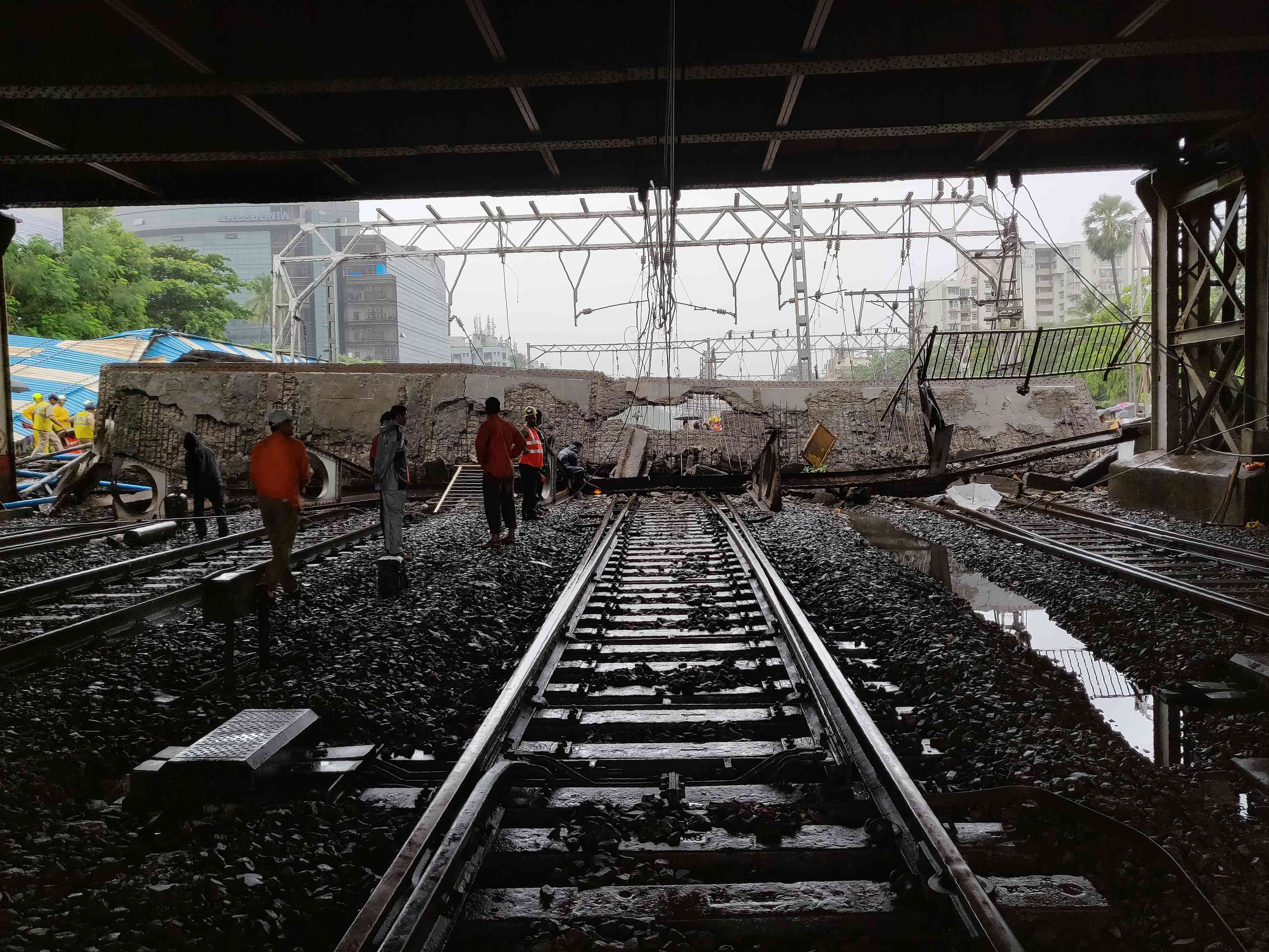 On July 3, a large section of an east-west connector bridge by Andheri suburban railway station collapsed, injuring five people. One of the women injured in the accident died four days later. (Photo credit: AFP).