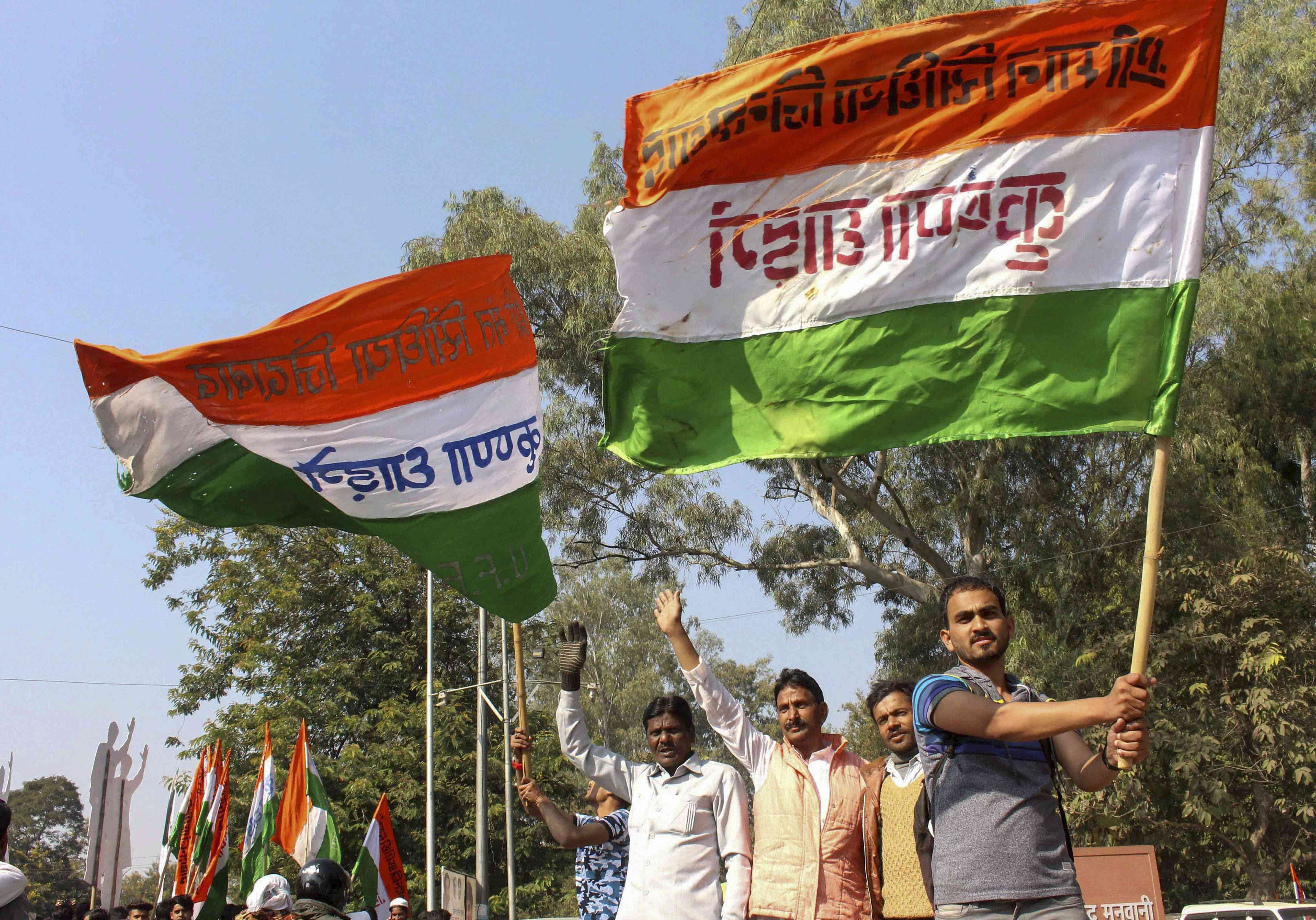 Congress workers celebrate at the party headquarters in Bhopal on Tuesday. (PTI Photo)