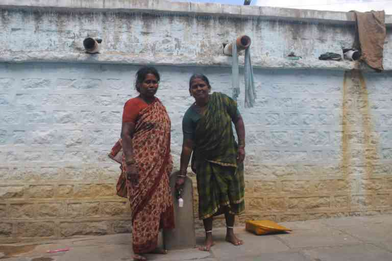 Devamma and Buchamma at Hanwada with the water tap outside their homes. Photo Credit: Meena Menon