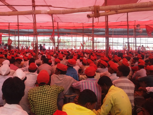 A sea of protesters in red caps at the farmers' protest in Azad Maidan on Monday. Photos: Aarefa Johari