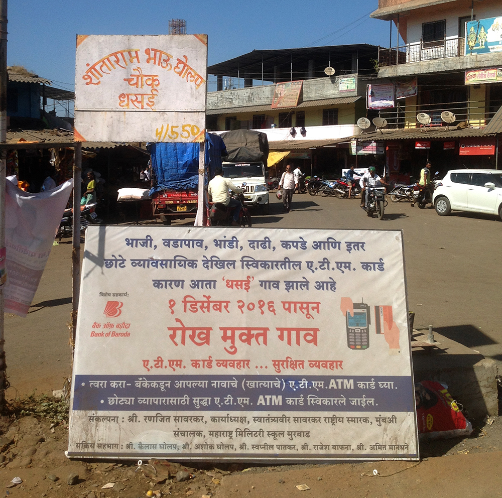 A signboard on Dhasai's main road gives an idea of the businesses now offering cashless transactions.