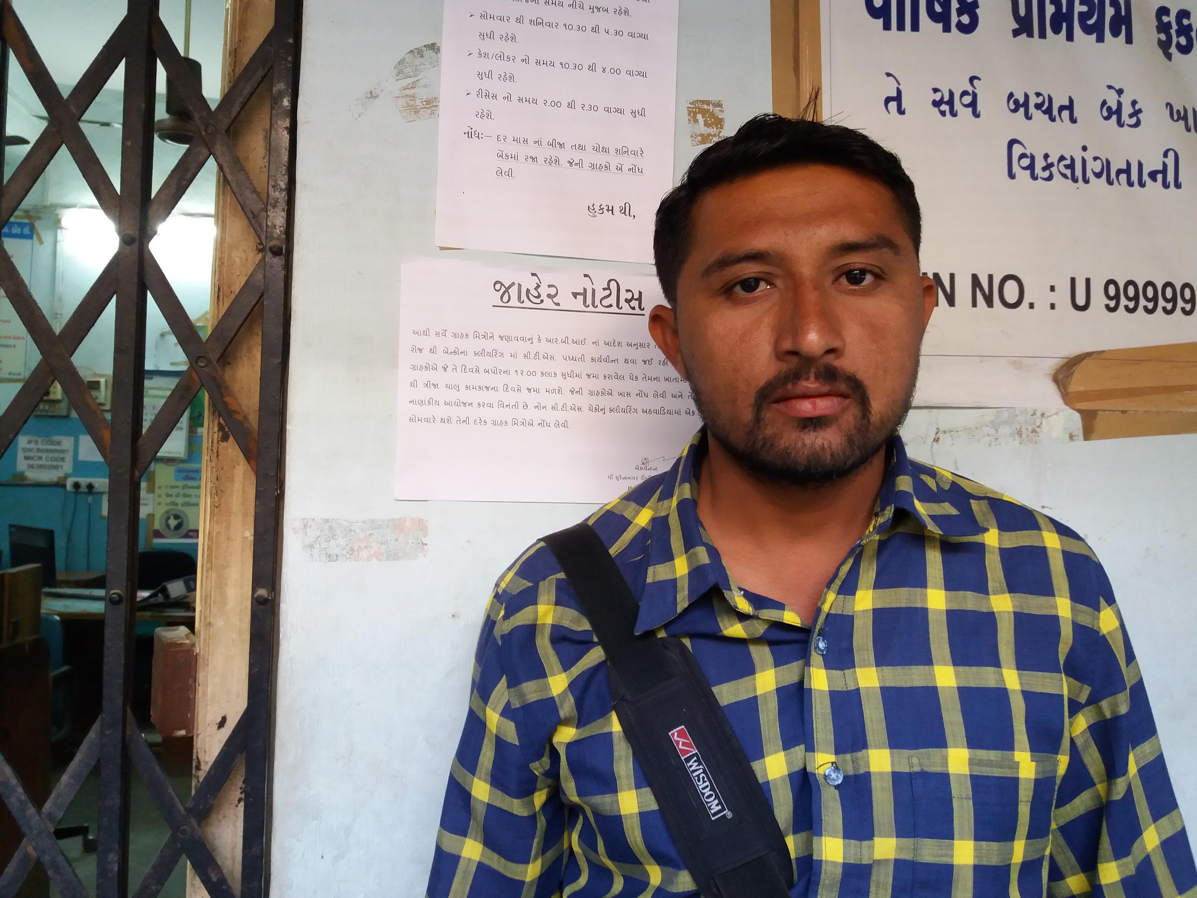 Tejabhai Tamaliya, a dairy cooperative secretary, at the Surendranagar District Cooperative Bank.
