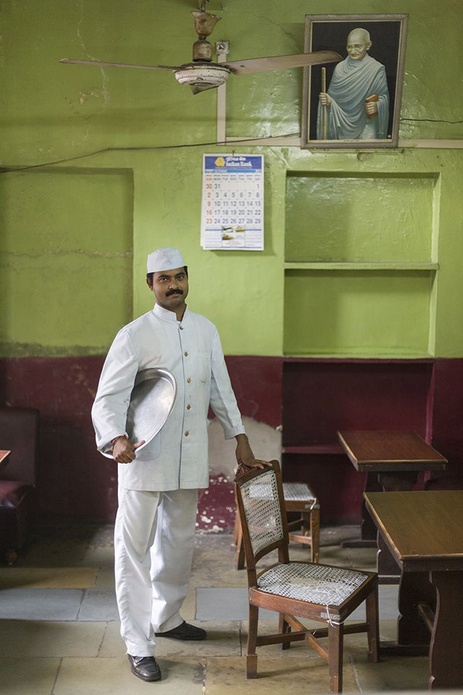 Sri Kumar, a waiter in the Indian Coffee House. Originally from Kerala, Kumar has worked at the Coffee House for eight years. Jaipur, India.  (© Stuart Freedman, Courtesy Tasveer)