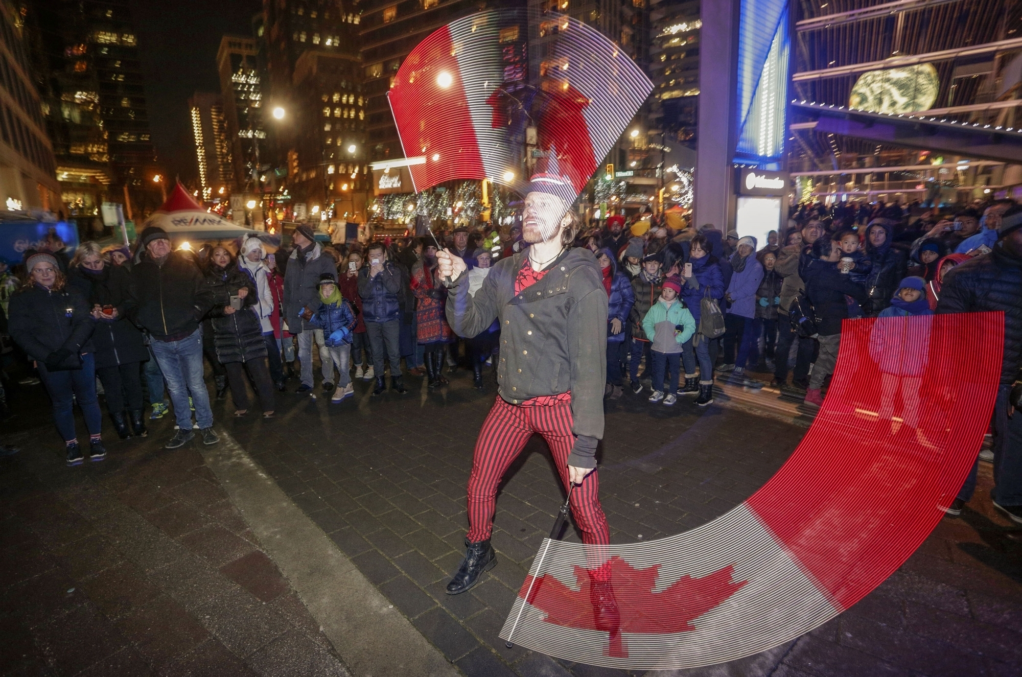 A performer plays LED sticks during the New Year celebrations at Canada Place in Vancouver, Canada. (Image Credit: Xinhua/IANS)