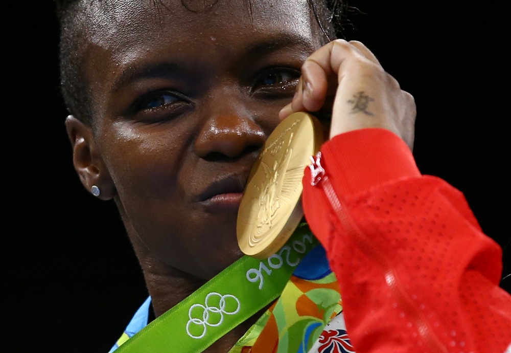 Great Britain's Nicola Adams won her second consecutive Olympic gold in the women's 51 kg flyweight boxing event. Image credit: Peter Cziborra / Reuters