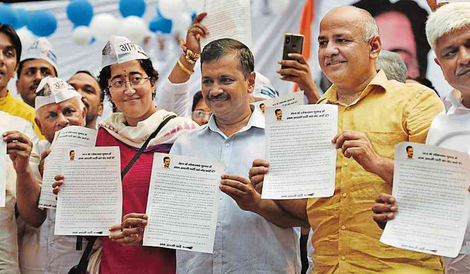 Atishi with Delhi Chief Minister Arvind Kejriwal and his deputy Manish Sisodia. (Photo credit: HT).