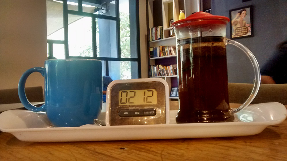 The French press is served with a timer.