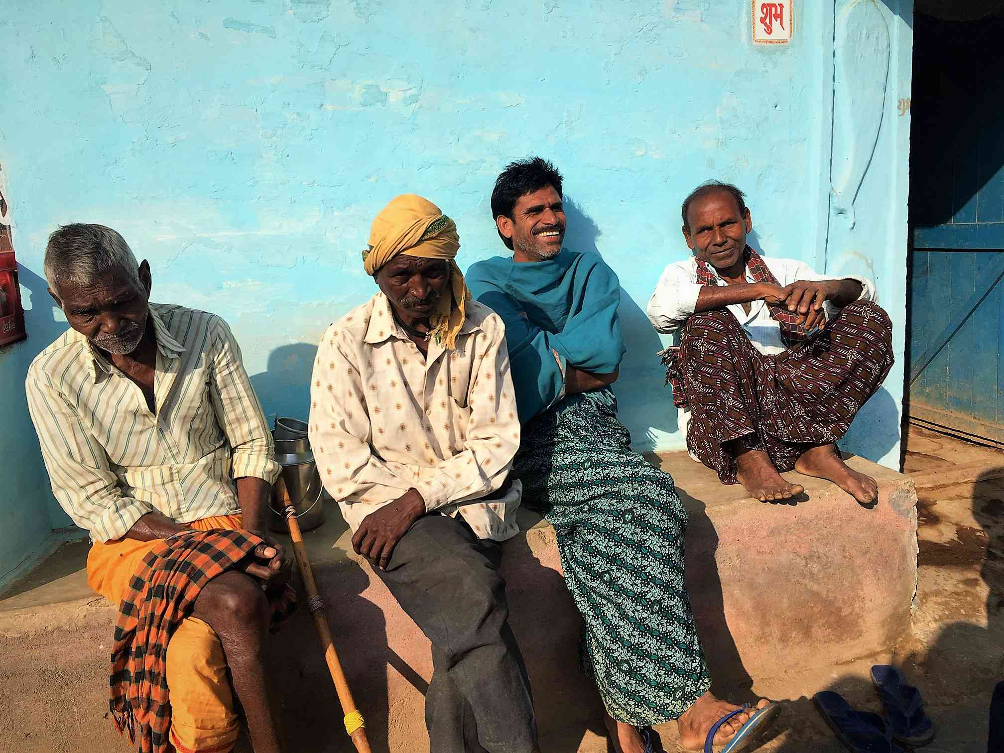 Mahesh Chandrakar, in blue, has been advising fellow farmers to wait until the Assembly election result is declared to sell their paddy crop. Photo credit: Akash Bisht