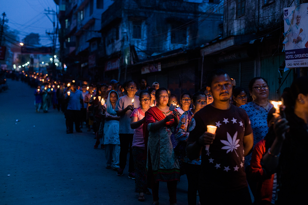 A candle-light march held on Sunday to mark the death of three activists who were allegedly killed in police firing on June 17.