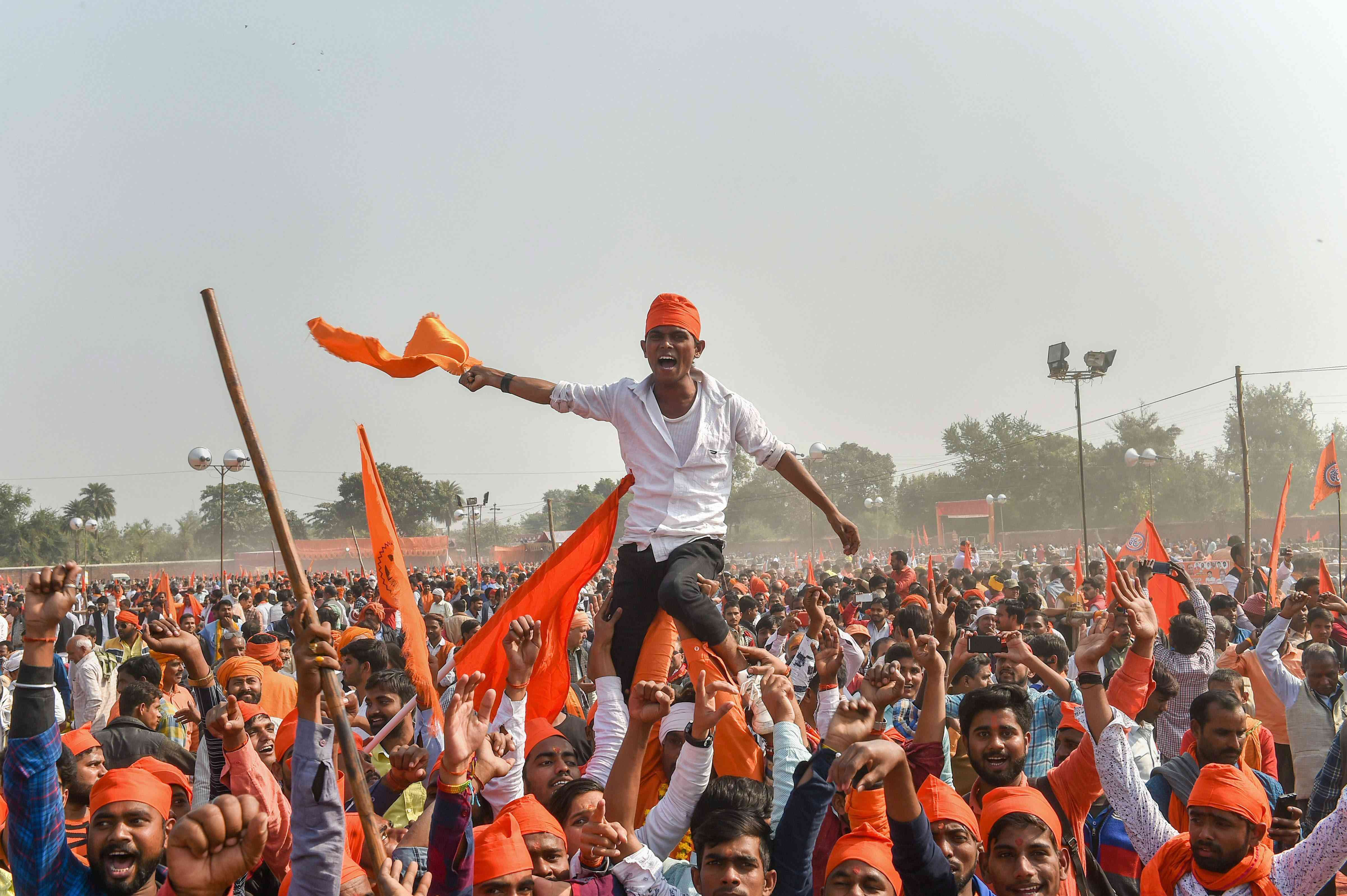 Supporters participate in the VHP's Dharma Sabha rally in Ayodhya on Sunday. (Image credit: PTI)