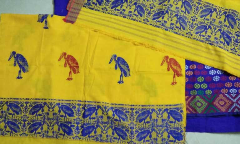 Silk with Greater Adjutant stork motifs. At present, village women have not been able to find a way to market these fine textiles, though it is hoped this could become possible in the future, benefiting both the villagers and the birds. Image Credit: Purnima Barman