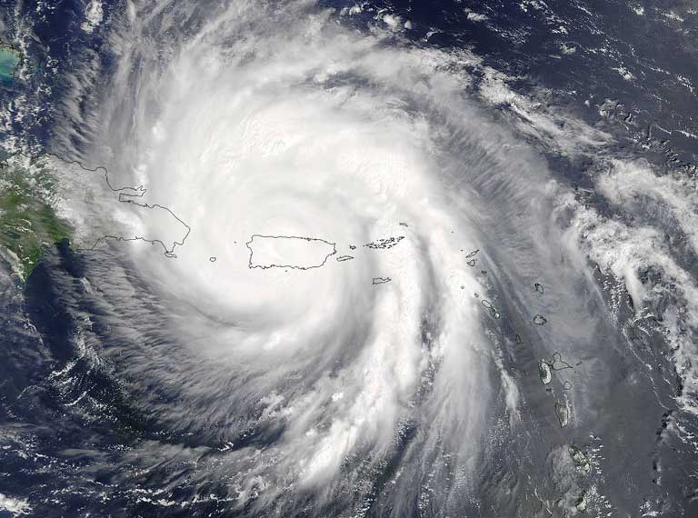 On September 20, at 10.50 am EDT NASA's Terra satellite provided this visible image as Hurricane Maria moved over Puerto Rico. The eye had become obscured by clouds. Photo credit: NASA Goddard MODIS Rapid Response Team