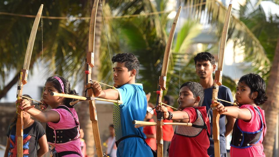Children try their hands at hitting the bull's eye during an archery workshop at Arjuna Sports Academy in Dadar. Credit: Pratik Chorge/HT Photo