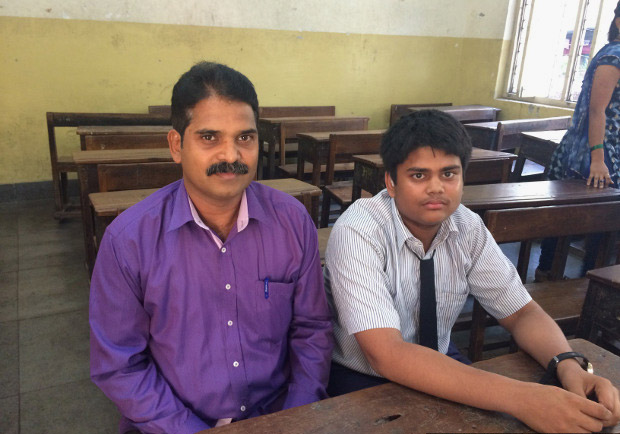 Deepak Khedekar with his son, Sahil, who suffers from hearing impairment and studies in Class 8 at the Baradevi Municipal School in Sewri, Mumbai. (Photo credit: Swagata Yadavar/Indiaspend.com)