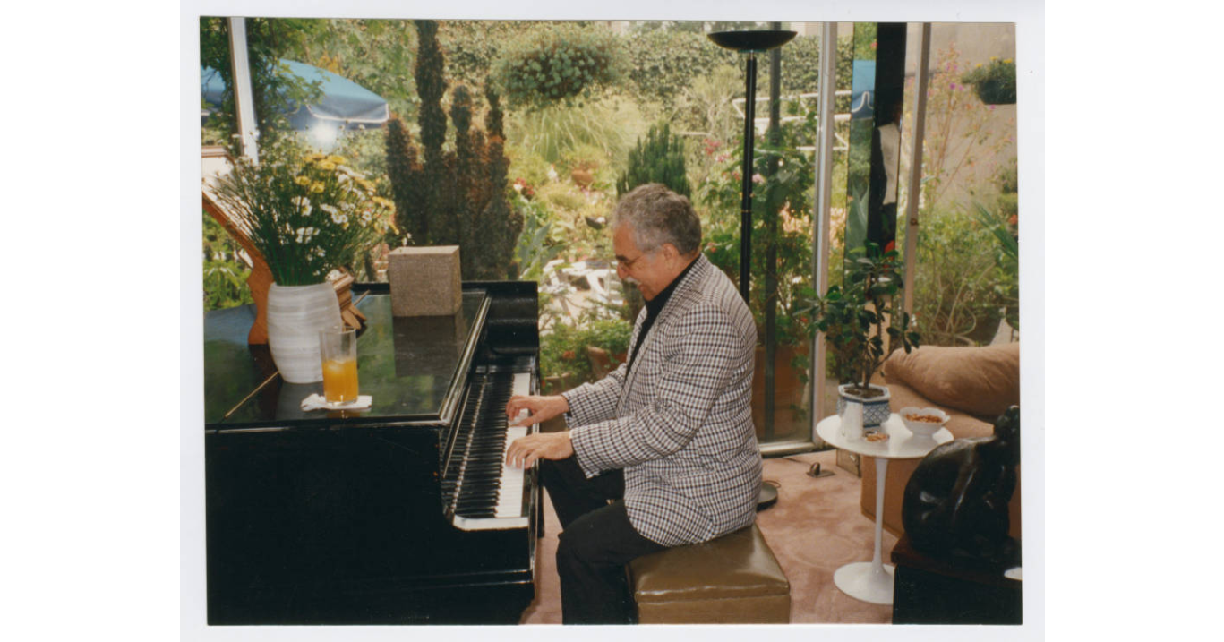 Marquez playing the piano, undated (Harry Ransom Center at The University of Texas, Austin)
