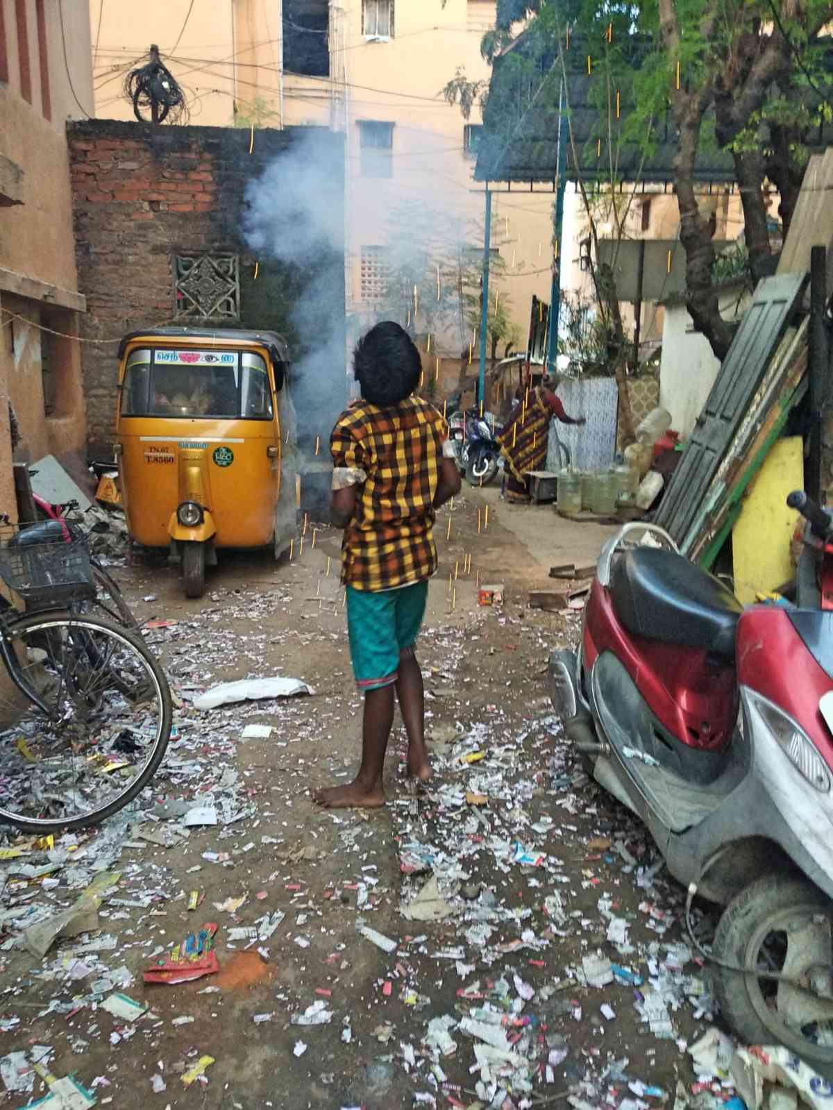 A boy bursts crackers on Tuesday evening in Chennai.  (Photo credit: S Senthalir).