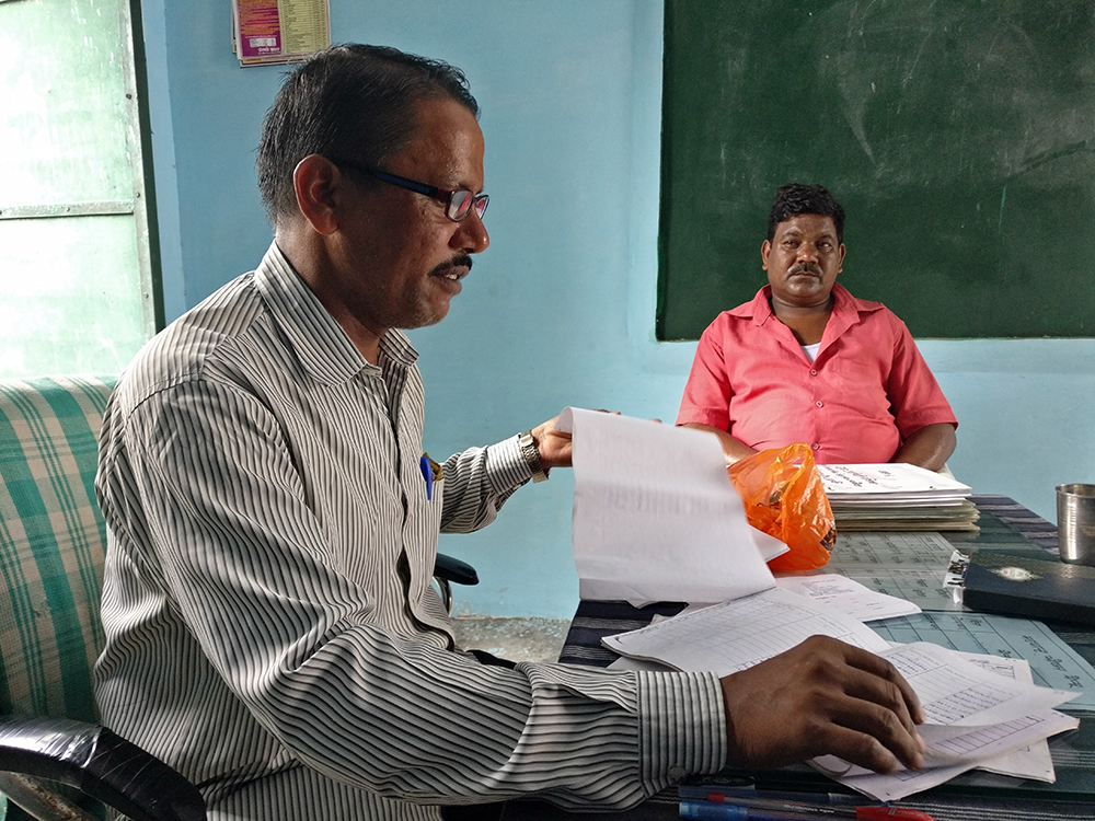 Bahadur Singh, principal of the upper primary school in Nanakheda, says he cannot complete the Aadhaar database of his students by the July 15 deadline. Photo credit: Shreya Roy Chowdhury