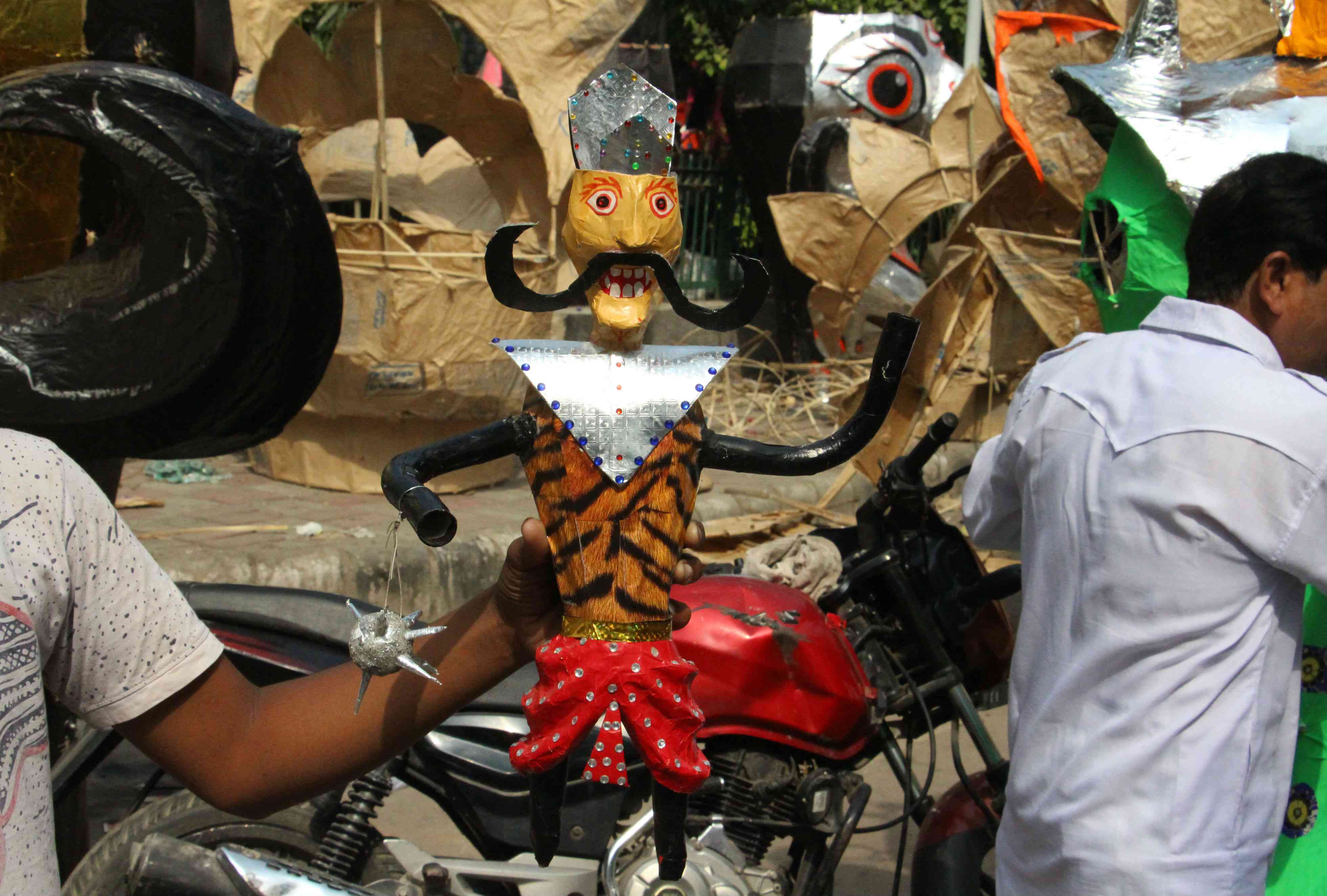 Schoolboy Jugnu Kumar (not in picture) made this small Ravan effigy to earn some pocket money. Effigies like this can fetch around Rs 500 each.