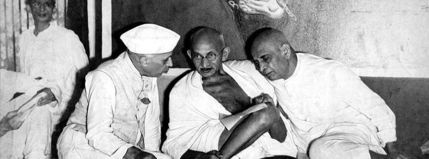Mahatma Gandhi with Jawaharlal Nehru and Vallabhbhai Patel at a Congress meeting. Patel sought to take the party in a conservative direction, which Nehru opposed. (Credit: Wikimedia Commons)