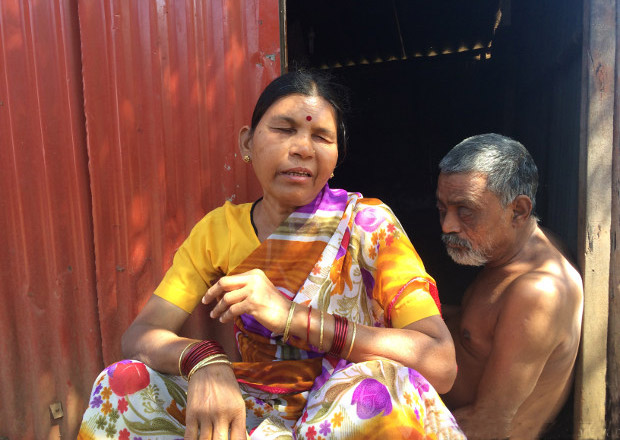 Asha, 40, and her husband Manohar Waghmare, 60, at heir house in Vangani. Manohar has had paralysis in his legs since the age of two, and both he and Asha are visually impaired. The couple have no source of income and their neighbours take care of them. ( Photo credit: Swagata Yadavar/Indiaspend.com)