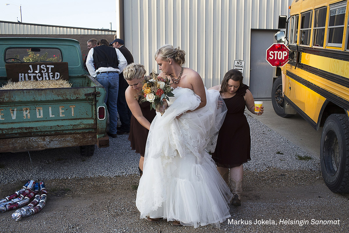 Long-Term Projects, third prize | Table Rock, Nebraska: Kelly Freeman arrives at her wedding reception in Dubois, Kansas, October 2013. (Markus Jokela for Helsingin Sanomat)
