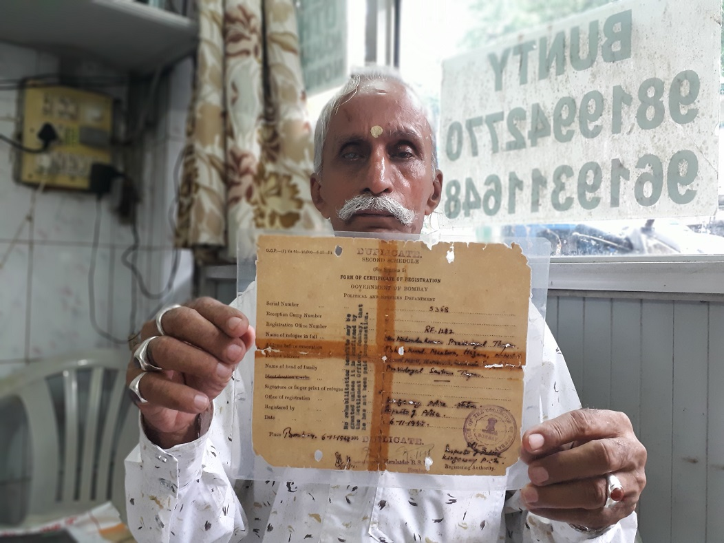 Mahendra Kumar Thapar with his refugee card from 1947.