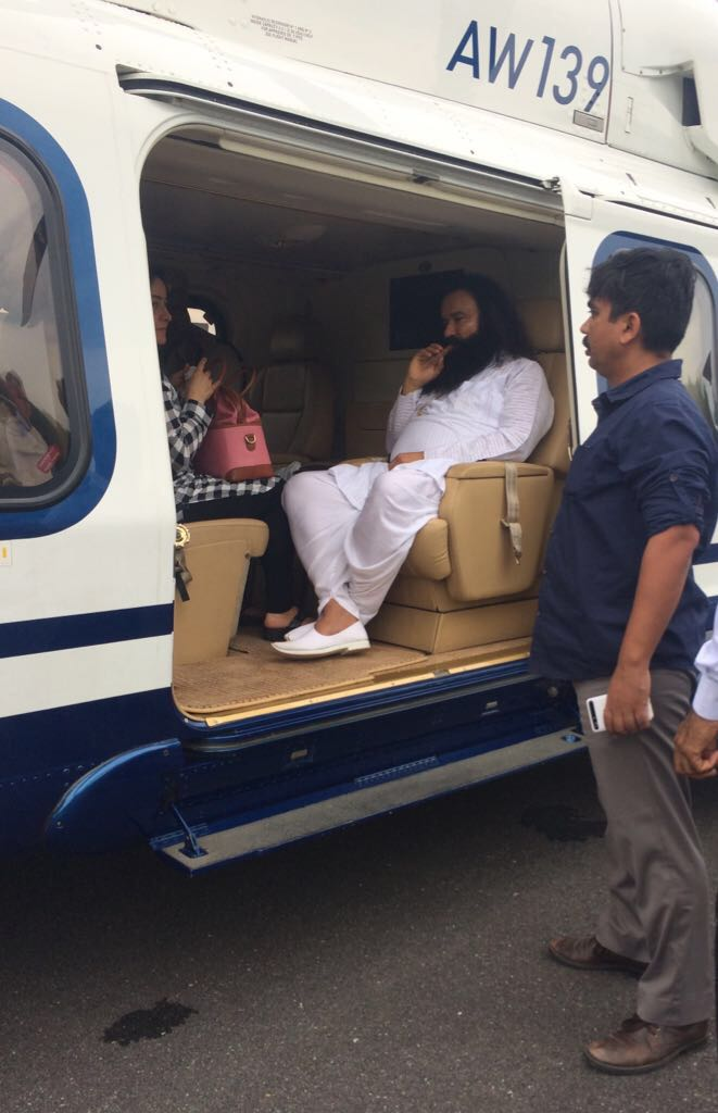 This image shows Gurmeet Ram Rahim Singh with his adopted daughter Honeypreet Insan on board an AgustaWestland helicopter.