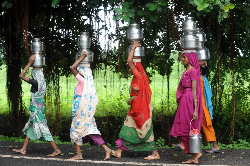 Women carry drinking water at Tilakwada village at Kevadia Colony in Narmada district of Gujarat. (Photo credit: AFP/Sam Panthaky).