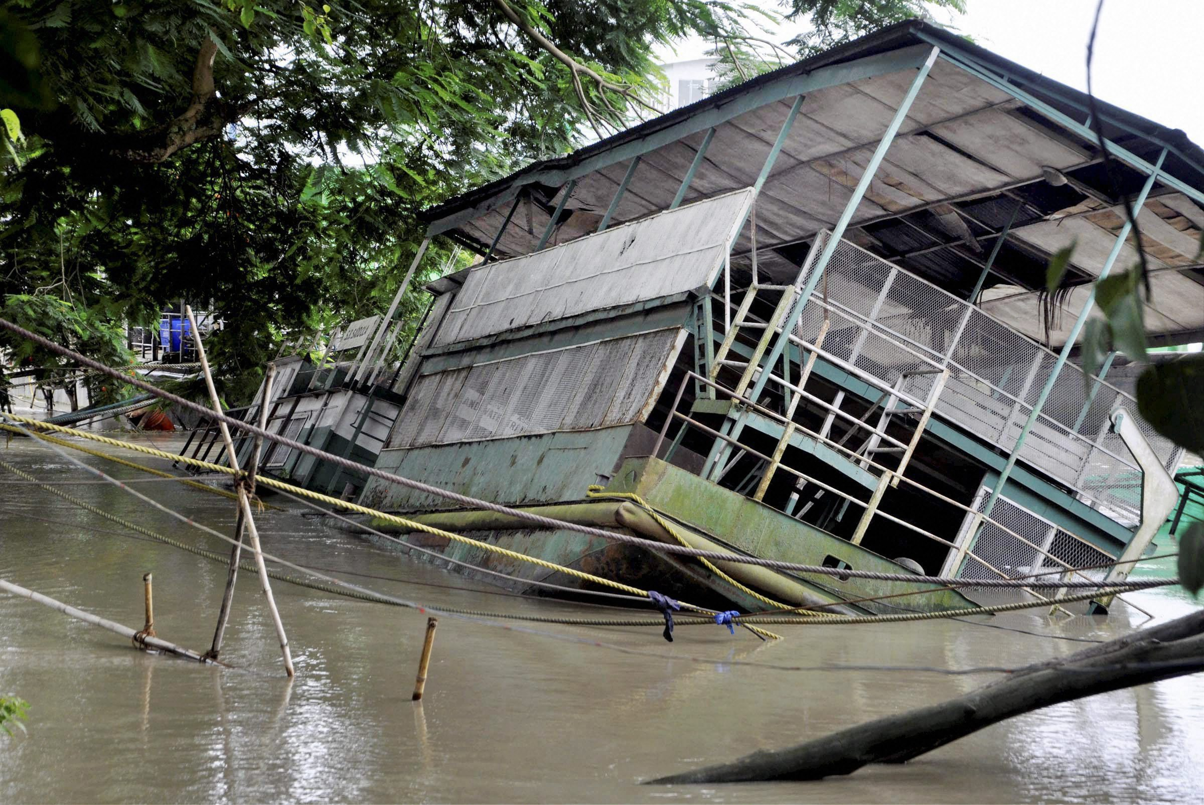 The Rajaduwar Ghat in Guwahati submerged by the flooded Brahmaputra river in on Sunday. PTI Photo.