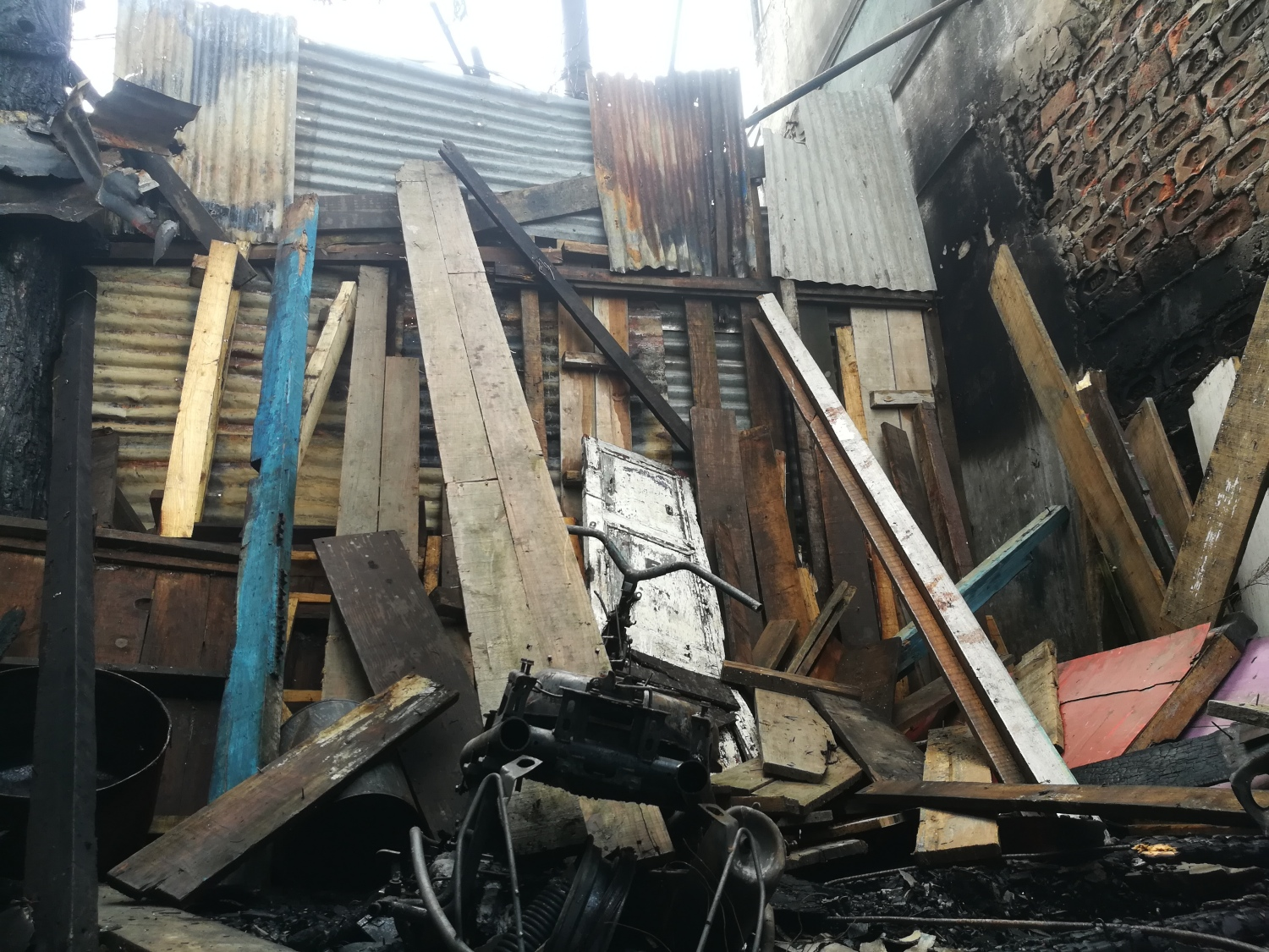 On Friday night, a mob threw petrol bombs and stones over the walls of the Sweepers Colony, which set this hair-cutting salon on fire.