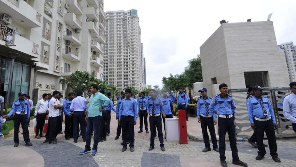 Security guards outside Mahagun Moderne in Noida's Sector 78 on Wednesday. (Credit: Sunil Ghosh / HT)