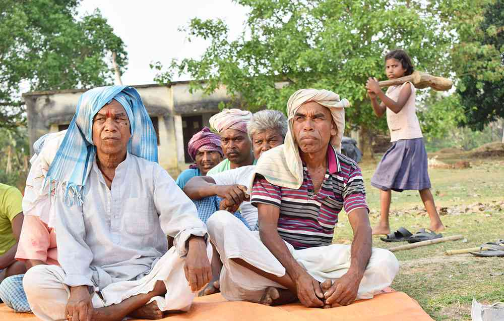 """Why don't they just make the power plant in Bangladesh? Why must they pollute our water and cut our trees?"" said Sushil Hembrom, a Santhal Adivasi elder from the village of Gangta, where Adani Power seeks to acquire land. Photo credit: Aruna Chandrasekhar"