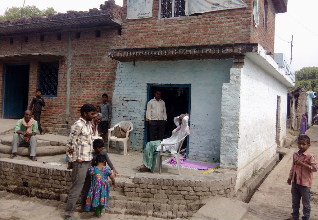 Residents  gather near the village well