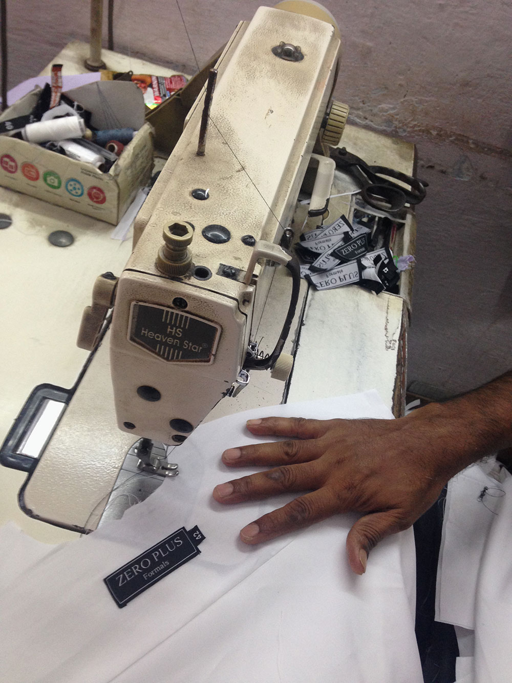A worker stitching a shirt for Zero Plus at the garment factory in Delhi. Photo credit: Sunaina Kumar