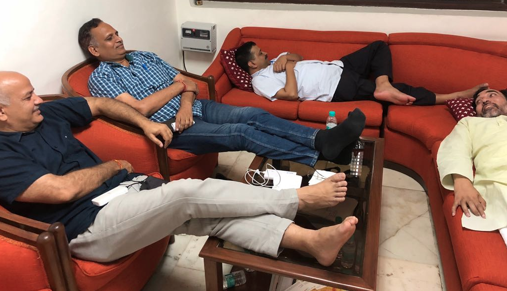 Delhi Chief Minister Arvind Kejriwal and his ministers on dharna in the waiting room at Raj Niwas, the lieutenant general's official residence. (Credit: @sharmanagendar / Twitter)