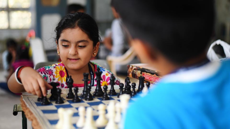 A child makes her move while learning chess during a summer camp at Bal Bhavan, in Mumbai. Photo credit: Pratik Chorge/HT Photo