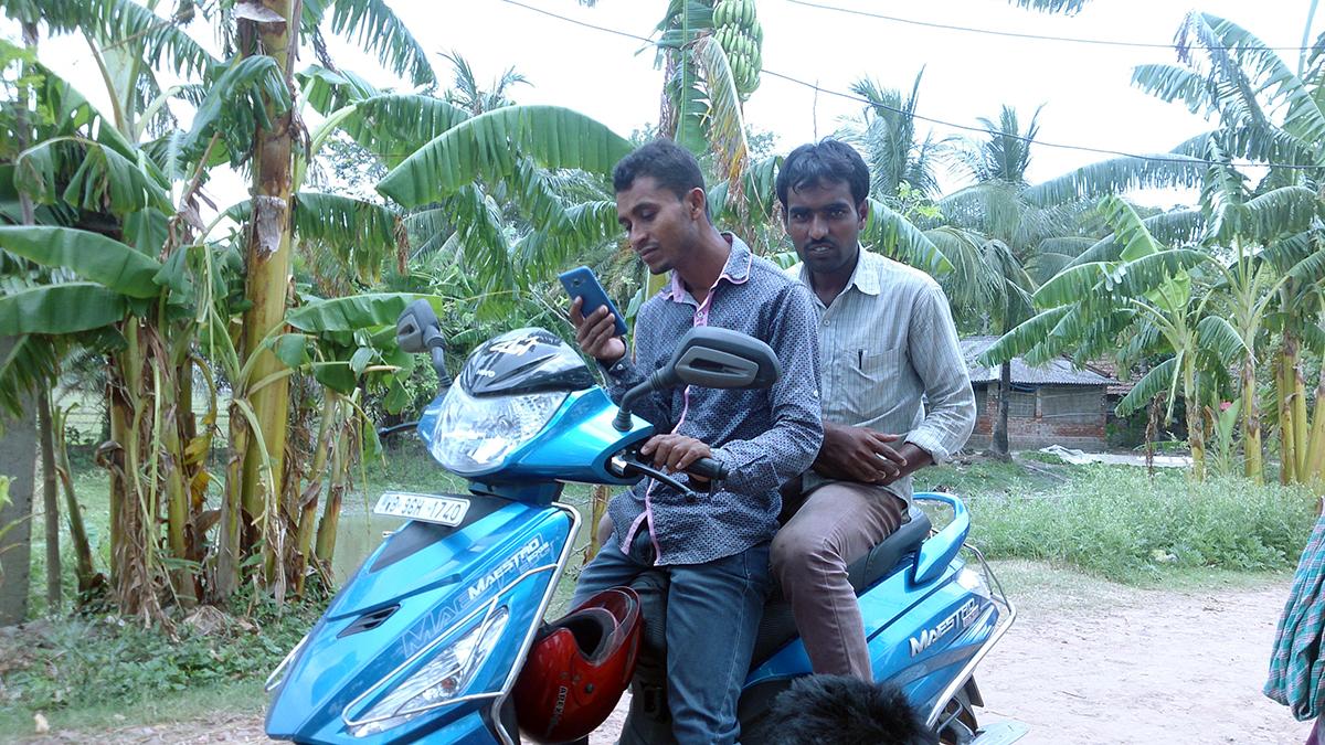 Polling agent Monirul Islam (pillion rider).
