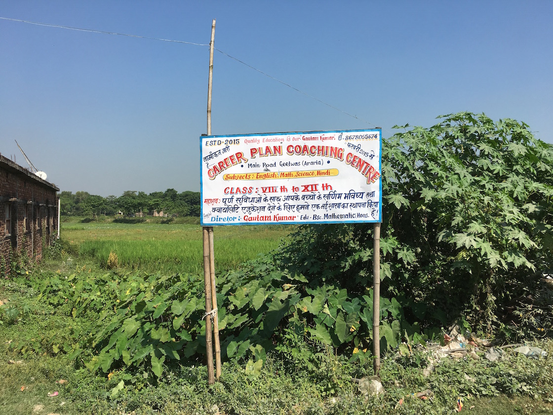 The board on a road passing through Geetwas village advertises the services of Career Plan Coaching Centre.