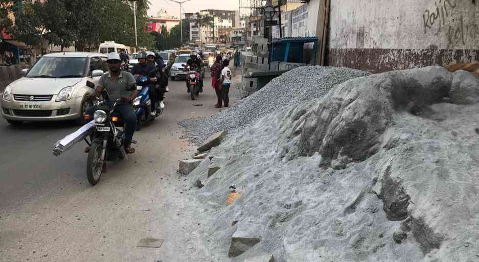 Construction Material Dumped on footpath leaving no room for pedestrians. Credit: The Footpath Initiative
